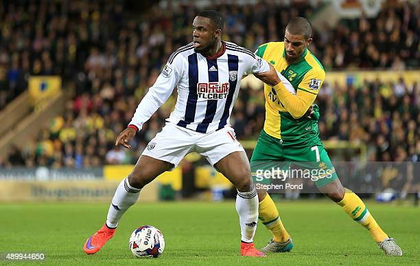 Victor Anichebe of West Bromwich Albion and Lewis Grabban of Norwich City compete for the ball during the Capital One Cup Third Round match between...