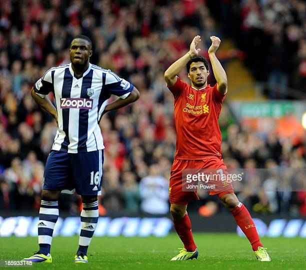 Victor Anichebe of West Bromwich Albion and Luis Suarez of Liverpool react at the end of the Barclays Premier League match between Liverpool and West...