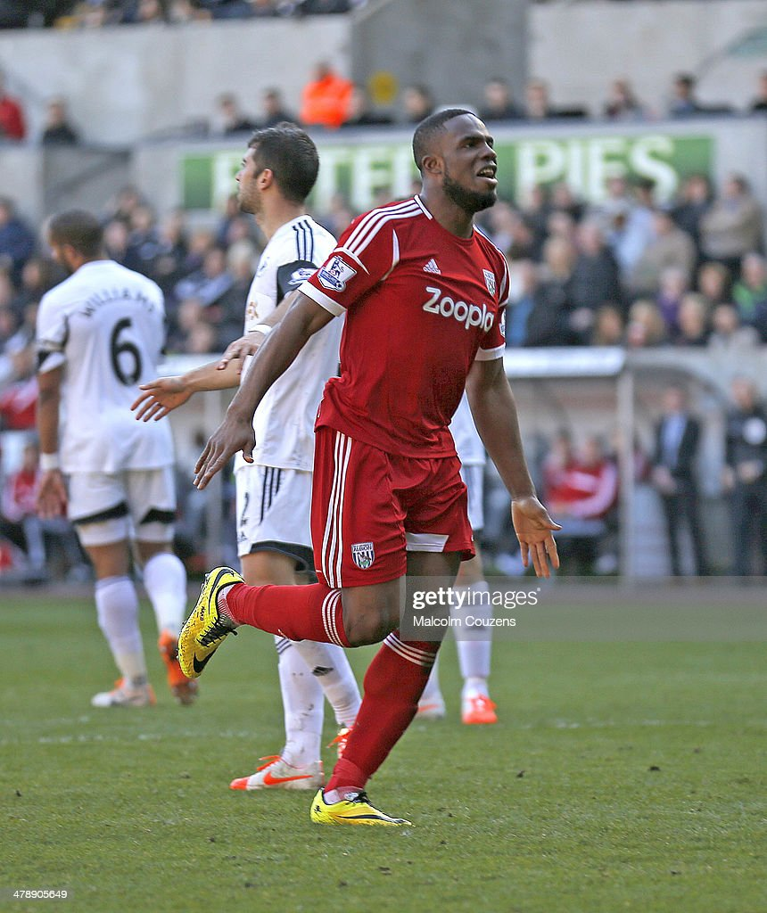 Victor Anichebe of West Bromwich Albion celebrates the goal scored by Stephane Sessegnon during the Barclays Premier League match between Swansea City and West Bromwich Albion at The Liberty Stadium on March 15, 2014 in Swansea, Wales.