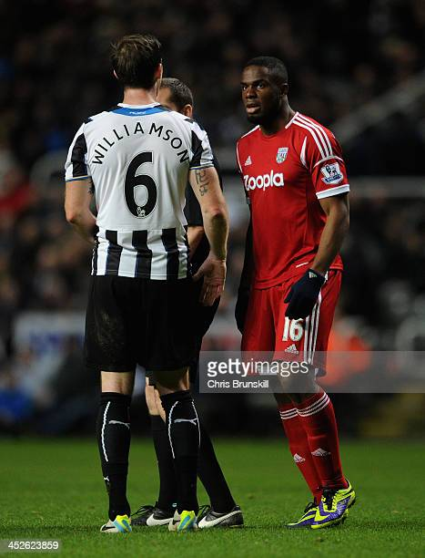 Victor Anichebe of West Bromwich Albion clashes with Mike Williamson of Newcastle United during the Barclays Premier League match between Newcastle...