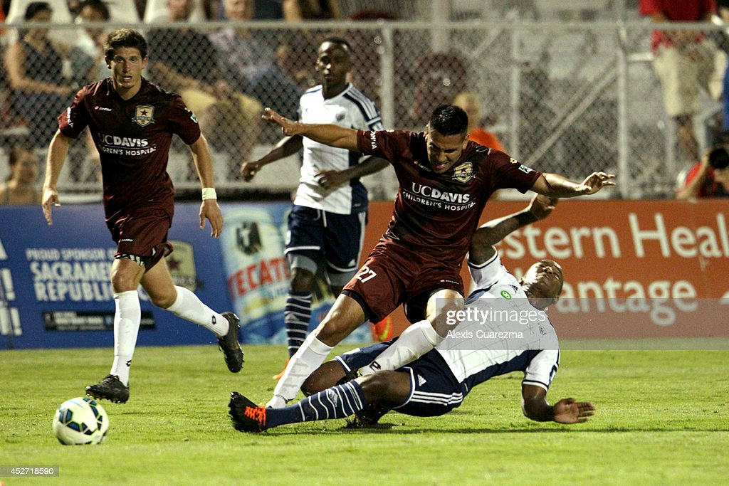 Victor Anichebe of West Bromwich Albion tackles Alvas Powell of the Sacramento Republic during the friendly match between West Bromwich Albion and...