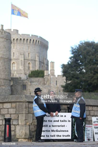 Victor Barker whose son James was killed in the 1998 Omagh bombing protests outside Windsor Castle ahead of the attendance of Deputy First Minister...