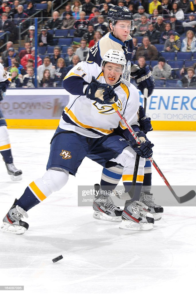 Victor Bartley #64 of the Nashville Predators and <a gi-track='captionPersonalityLinkClicked' href=/galleries/search?phrase=Ryan+Johansen&family=editorial&specificpeople=6698841 ng-click='$event.stopPropagation()'>Ryan Johansen</a> #19 of the Columbus Blue Jackets battle for possession of the puck during the first period on March 19, 2013 at Nationwide Arena in Columbus, Ohio.
