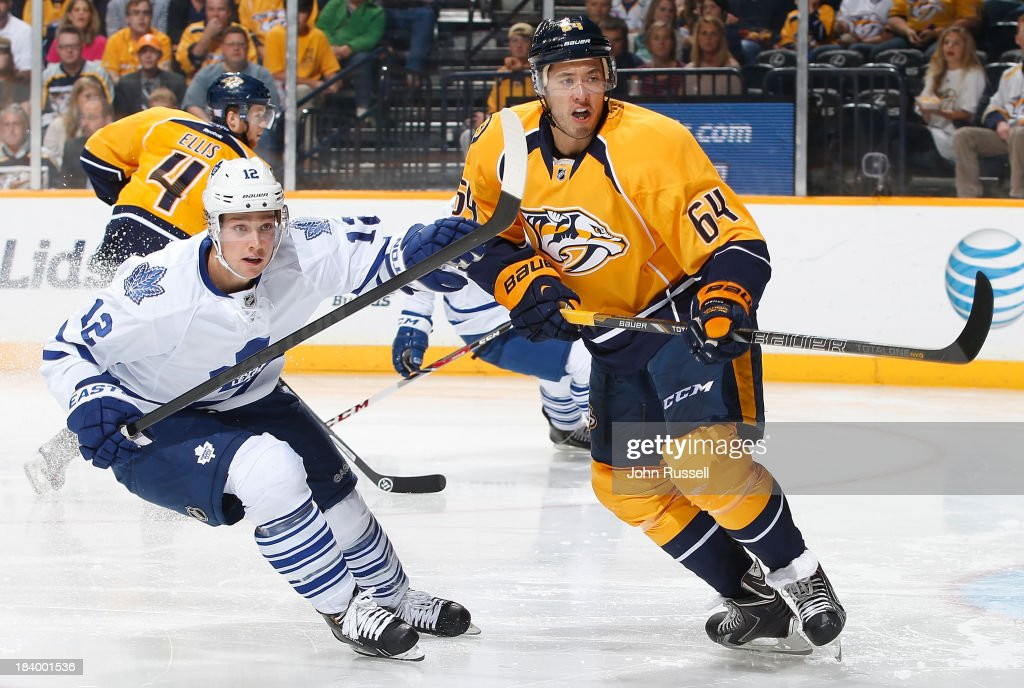 <a gi-track='captionPersonalityLinkClicked' href=/galleries/search?phrase=Victor+Bartley&family=editorial&specificpeople=570430 ng-click='$event.stopPropagation()'>Victor Bartley</a> #64 of the Nashville Predators skates against <a gi-track='captionPersonalityLinkClicked' href=/galleries/search?phrase=Mason+Raymond&family=editorial&specificpeople=4521385 ng-click='$event.stopPropagation()'>Mason Raymond</a> #12 of the Toronto Maple Leafs at Bridgestone Arena on October 10, 2013 in Nashville, Tennessee.