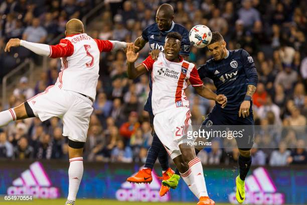 Victor Bernardez and Fatai Alashe of San Jose Earthquakes attempt to fend off Dom Dwyer and Ike Opara of Sporting Kansas City early in the first half...