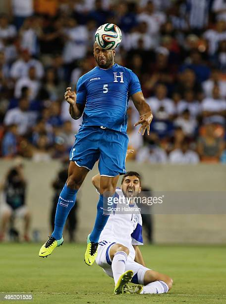 Victor Bernardez of Honduras battles for the ball with Muans Dabbur of Isreal during their Road to Brazil match at BBVA Compass Stadium on June 1...