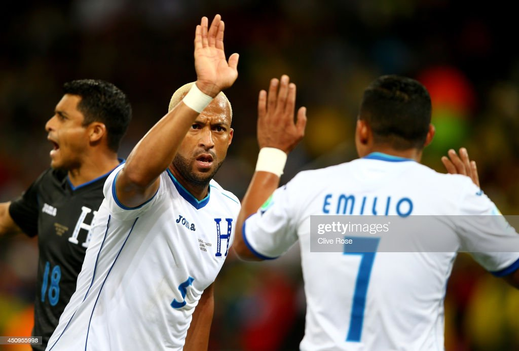 <a gi-track='captionPersonalityLinkClicked' href=/galleries/search?phrase=Victor+Bernardez&family=editorial&specificpeople=2952273 ng-click='$event.stopPropagation()'>Victor Bernardez</a> of Honduras reacts with teammate <a gi-track='captionPersonalityLinkClicked' href=/galleries/search?phrase=Emilio+Izaguirre&family=editorial&specificpeople=880126 ng-click='$event.stopPropagation()'>Emilio Izaguirre</a> during the 2014 FIFA World Cup Brazil Group E match between Honduras and Ecuador at Arena da Baixada on June 20, 2014 in Curitiba, Brazil.