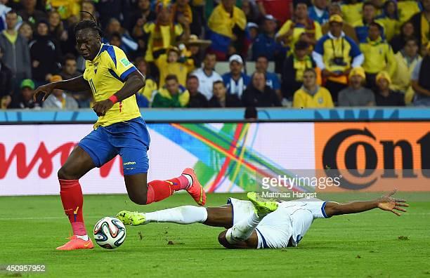 Victor Bernardez of Honduras tackles Jerry Bengtson of Honduras during the 2014 FIFA World Cup Brazil Group E match between Honduras and Ecuador at...