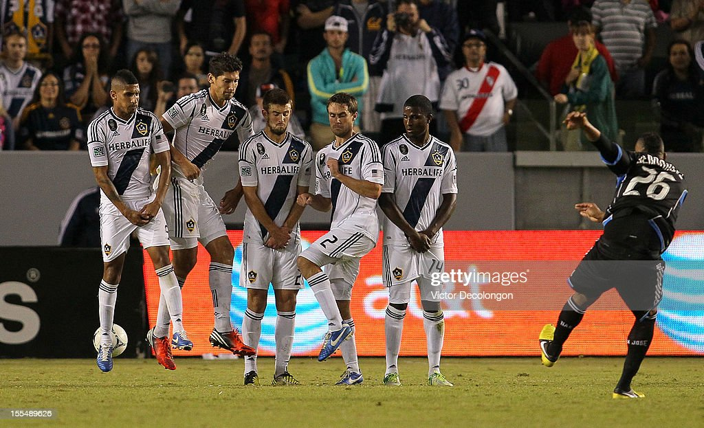 <a gi-track='captionPersonalityLinkClicked' href=/galleries/search?phrase=Victor+Bernardez&family=editorial&specificpeople=2952273 ng-click='$event.stopPropagation()'>Victor Bernardez</a> #26 of the San Jose Earthquakes scores from the direct free kick in the 90th minute of the first leg of the MLS Western Conference Semifinal match against the Los Angeles Galaxy at The Home Depot Center on November 4, 2012 in Carson, California. The Earthquakes defeated the Galaxy 1-0.