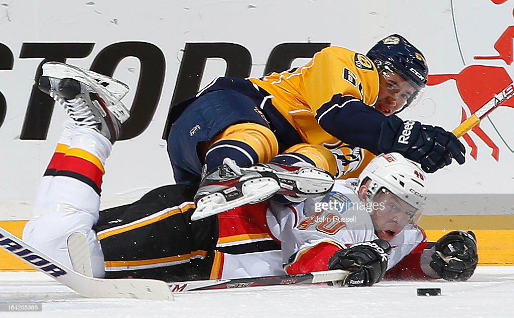 Victor Brantley #64 of the Nashville Predators battles for the puck against <a gi-track='captionPersonalityLinkClicked' href=/galleries/search?phrase=Alex+Tanguay&family=editorial&specificpeople=203231 ng-click='$event.stopPropagation()'>Alex Tanguay</a> #40 of the Calgary Flames during an NHL game at the Bridgestone Arena on March 21, 2013 in Nashville, Tennessee.