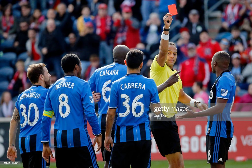 Victor Cabrera #36 of Montreal Impact receives a red card for denying an obvious goal scoring opportunity by referee Ismail Elfath during the second half of their game against the Chicago Fire at Toyota Park on April 1, 2017 in Bridgeview, Illinois. The match ended in a 2-2 draw.