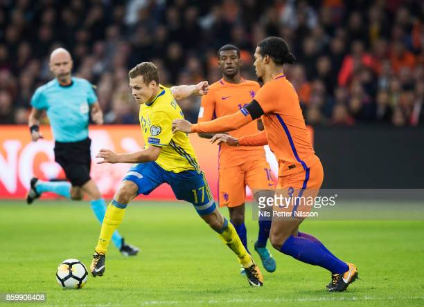Victor Claesson of Sweden and Virgil Van Dijk of Netherlands competes for the ball during the FIFA 2018 World Cup Qualifier between Netherlands and...