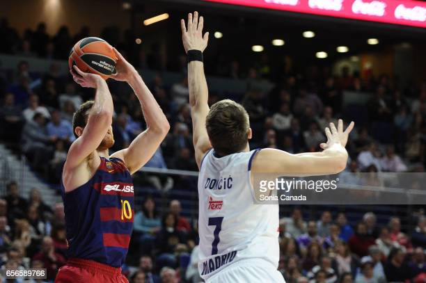 Victor Claver #10 forward of FC Barcelona and Luka Doncic #7 guard of Real Madrid during the 2016/2017 Turkish Airlines Euroleague Regular Season...