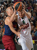 Victor Claver #9 of lokomotiv Kuban Krasnodar competes with Carlos Arroyo #30 of FC Barcelona Lassa during the Turkish Airlines Euroleague Regular...