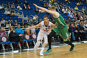 Victor Claver #9 of Lokomotiv Kuban Krasnodar competes with Davis Bertans #42 of Laboral Kutxa Vitoria Gasteiz during the Turkish Airlines Euroleague...
