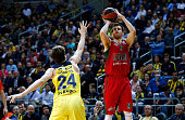 Victor Claver #9 of Lokomotiv Kuban Krasnodar competes with Jan Vesely #24 of Fenerbahce Istanbul during the Turkish Airlines Euroleague Basketball...