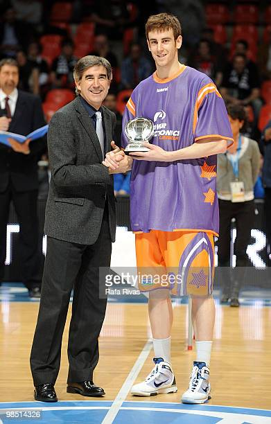 Victor Claver #9 of Power Electronics Valencia receives an award during the Best Season Players Award Ceremony at Fernando Buesa Arena on April 15...