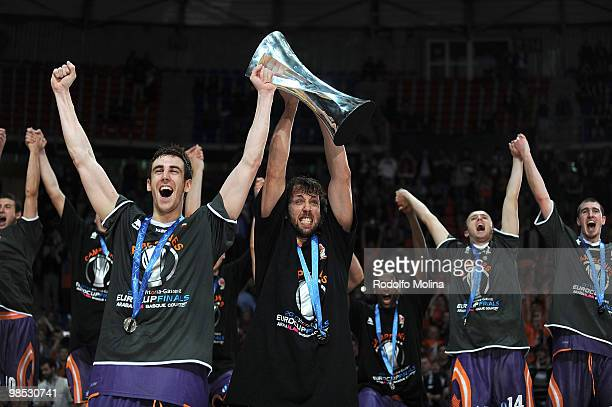 Victor Claver of Power Electronics Valencia and Matt Nielsen celebrate with the trophy during the Champion Award Ceremony at Fernando Buesa Arena on...