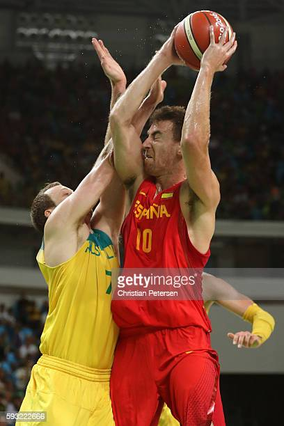 Victor Claver of Spain drives the basket against Joe Ingles of Australia during the Men's Basketball Bronze medal game between Australia and Spain on...