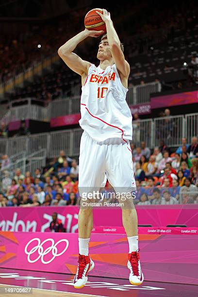 Victor Claver of Spain shoots against Great Britain in the first half during the Men's Basketball Preliminary Round match on Day 6 of the London 2012...