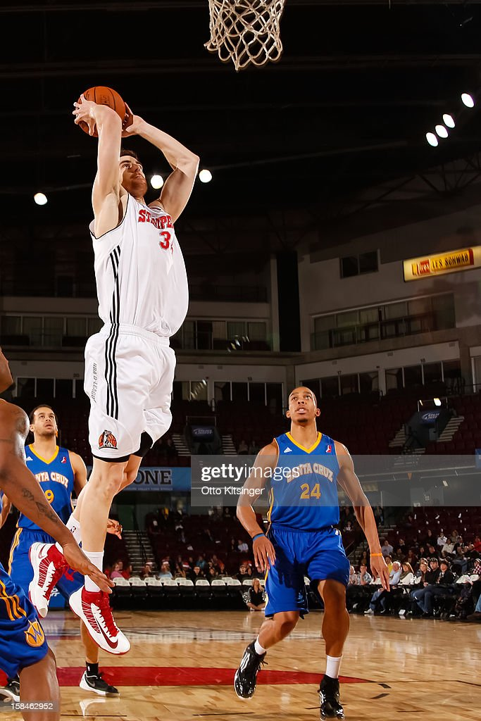 <a gi-track='captionPersonalityLinkClicked' href=/galleries/search?phrase=Victor+Claver&family=editorial&specificpeople=5562510 ng-click='$event.stopPropagation()'>Victor Claver</a> #34 of the Idaho Stampede goes up to the basket against the Santa Cruz Warriors on December 15, 2012 at CenturyLink Arena in Boise, Idaho. Claver was on assignment from the Portland Trail Blazers.