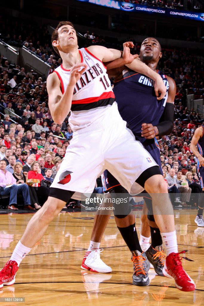 Victor Claver #18 of the Portland Trail Blazers battles for rebound position against Jeff Adrien #4 of the Charlotte Bobcats on March 4, 2013 at the Rose Garden Arena in Portland, Oregon.