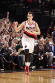 Victor Claver of the Portland Trail Blazers celebrates on the court during the game against the Los Angeles Clippers on April 16 2014 at the Moda...