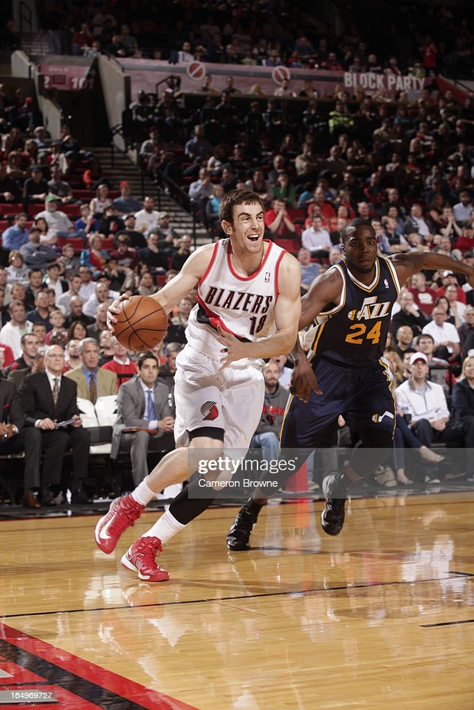 Victor Claver #18 of the Portland Trail Blazers drives to the basket against Paul Millsap #24 of the Utah Jazz on March 29, 2013 at the Rose Garden Arena in Portland, Oregon.