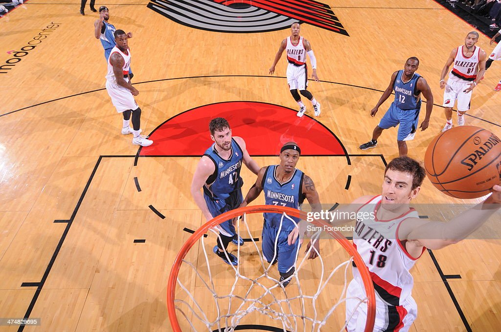 Victor Claver #18 of the Portland Trail Blazers drives to the basket against the Minnesota Timberwolves on February 23, 2014 at the Moda Center Arena in Portland, Oregon.