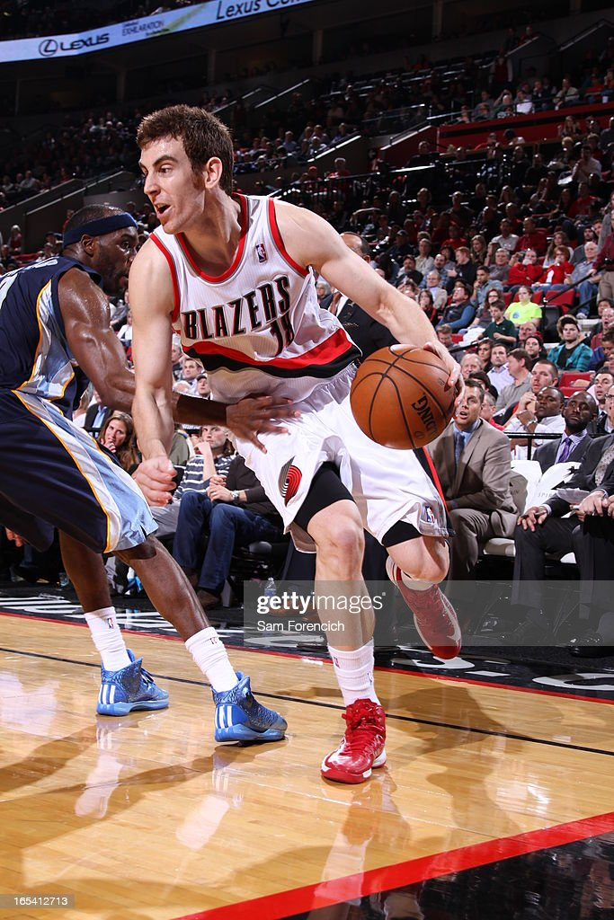 Victor Claver #18 of the Portland Trail Blazers drives under pressure during the game between the Memphis Grizzlies and the Portland Trail Blazers on April 3, 2013 at the Rose Garden Arena in Portland, Oregon.