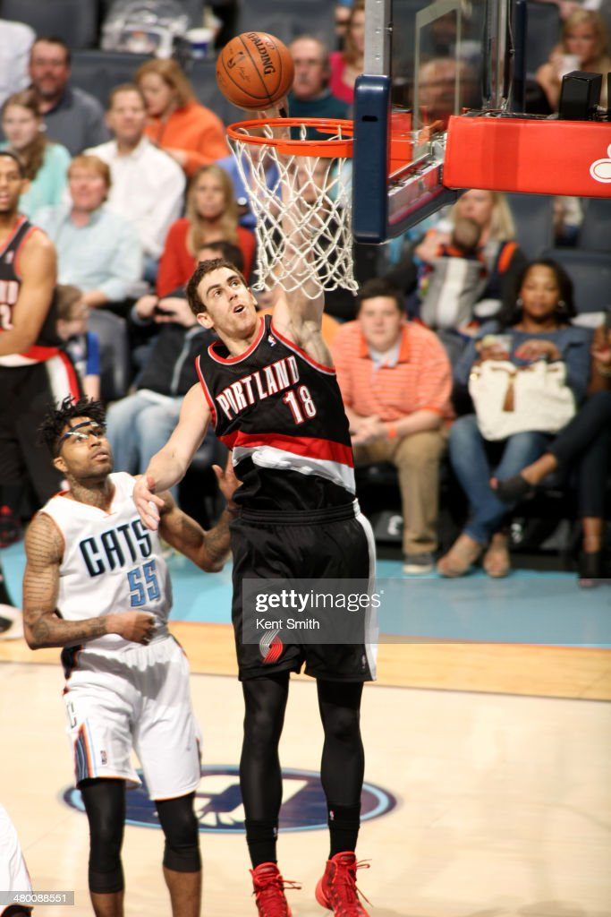 Victor Claver #18 of the Portland Trail Blazers dunks against the Charlotte Bobcats at the Time Warner Cable Arena on March 22, 2014 in Charlotte, North Carolina.