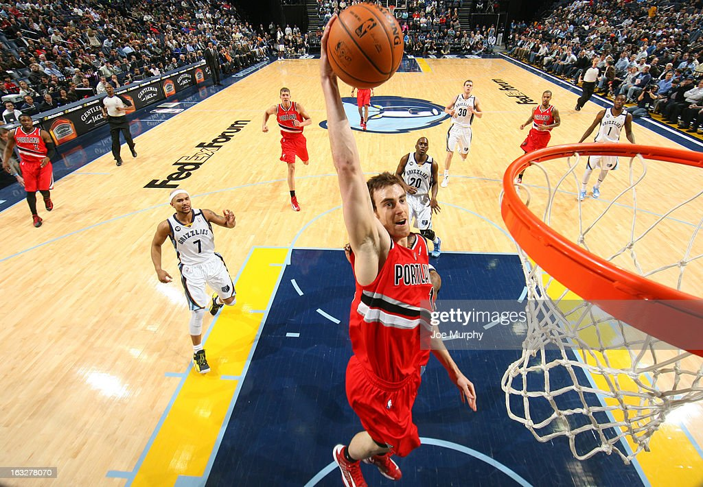 Victor Claver #18 of the Portland Trail Blazers dunks against the Memphis Grizzlies on March 6, 2013 at FedExForum in Memphis, Tennessee.