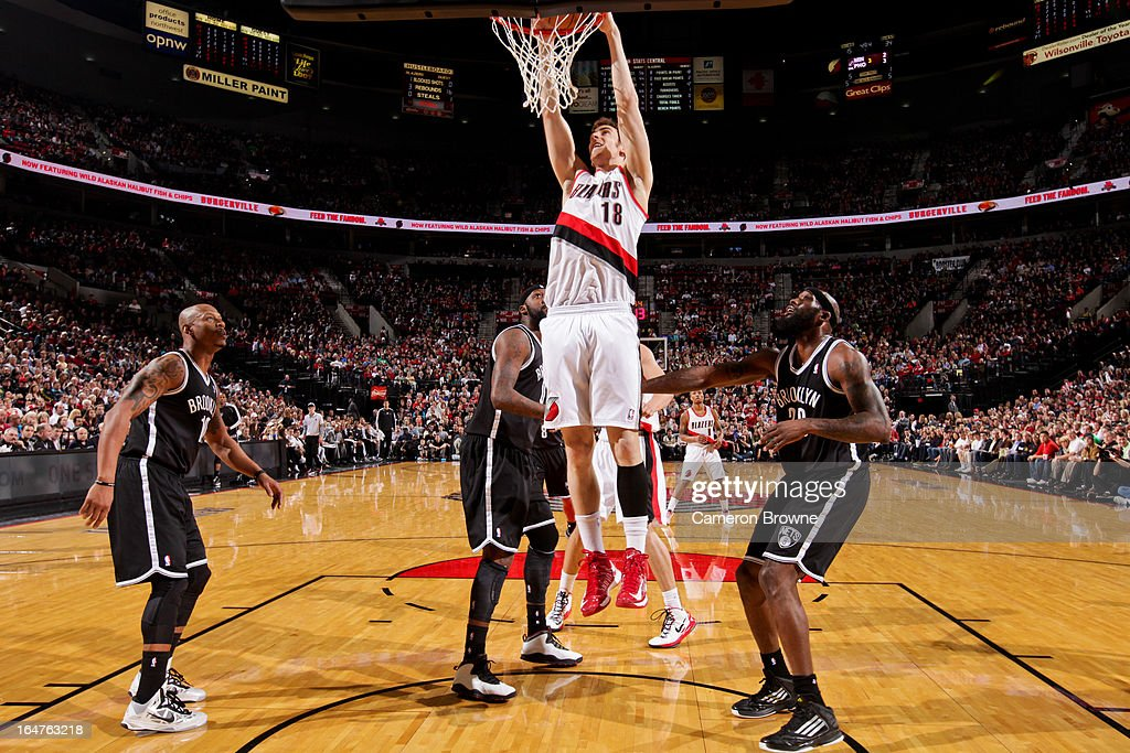 Victor Claver #18 of the Portland Trail Blazers dunks against the Brooklyn Nets on March 27, 2013 at the Rose Garden Arena in Portland, Oregon.