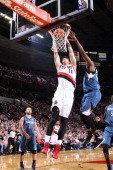 Victor Claver of the Portland Trail Blazers dunks during a game against the Minnesota Timberwolves on February 23 2014 at the Moda Center Arena in...