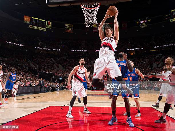 Victor Claver of the Portland Trail Blazers grabs a rebound against the New York Knicks on December 28 2014 at the Moda Center in Portland Oregon...