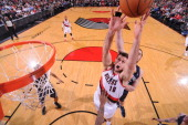 Victor Claver of the Portland Trail Blazers grabs a rebound against the Memphis Grizzlies on January 28 2014 at the Moda Center Arena in Portland...