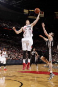 Victor Claver of the Portland Trail Blazers grabs a rebound against the San Antonio Spurs on February 19 2014 at the Moda Center Arena in Portland...