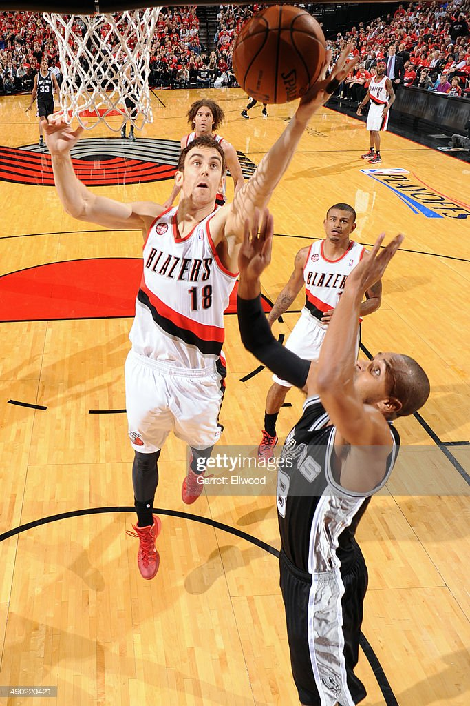 <a gi-track='captionPersonalityLinkClicked' href=/galleries/search?phrase=Victor+Claver&family=editorial&specificpeople=5562510 ng-click='$event.stopPropagation()'>Victor Claver</a> #18 of the Portland Trail Blazers lays the ball in the basket in Game Three of the Western Conference Semifinals against the San Antonio Spurs during the 2014 NBA Playoffs on May 10, 2014 at the Moda Center in Portland, Oregon.