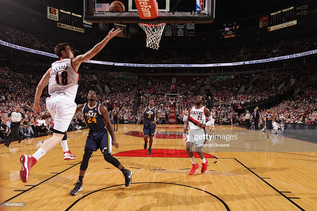 Victor Claver #18 of the Portland Trail Blazers shoots a layup against Paul Millsap #24 of the Utah Jazz on March 29, 2013 at the Rose Garden Arena in Portland, Oregon.