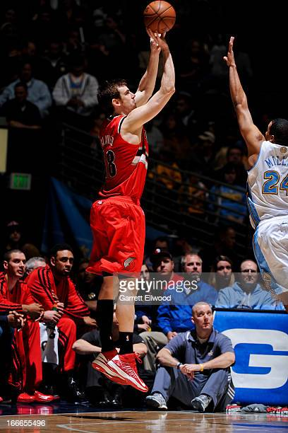 Victor Claver of the Portland Trail Blazers shoots a threepointer against Andre Miller of the Denver Nuggets on April 14 2013 at the Pepsi Center in...