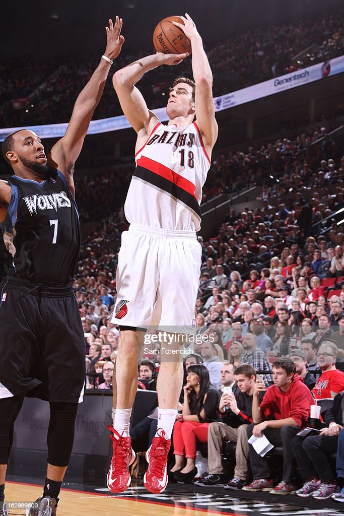 Victor Claver #18 of the Portland Trail Blazers shoots against Derrick Williams #7 of the Minnesota Timberwolves on March 2, 2013 at the Rose Garden Arena in Portland, Oregon.