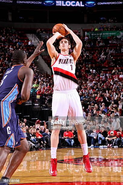 Victor Claver of the Portland Trail Blazers shoots against DeSagana Diop of the Charlotte Bobcats on March 4 2013 at the Rose Garden Arena in...