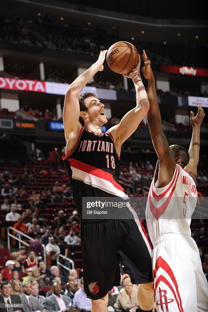 <a gi-track='captionPersonalityLinkClicked' href=/galleries/search?phrase=Victor+Claver&family=editorial&specificpeople=5562510 ng-click='$event.stopPropagation()'>Victor Claver</a> #18 of the Portland Trail Blazers takes a shot against James Anderson #5 of the Houston Rockets on February 8, 2013 at the Toyota Center in Houston, Texas.