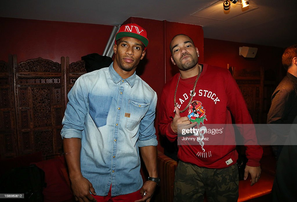 Victor Cruz and DJ Envy attend 'T.I. In Concert' at Best Buy Theater on December 18, 2012 in New York, United States.