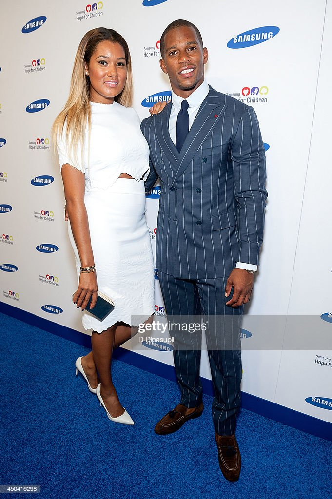 Victor Cruz (R) and Elaina Watley attend the 13th Annual Samsung Hope For Children Gala at Cipriani Wall Street on June 10, 2014 in New York City.