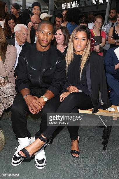 Victor Cruz and Elaina Watley attend the Givenchy show as part of the Paris Fashion Week Menswear Spring/Summer 2015 on June 27 2014 in Paris France