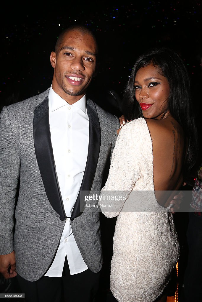 Victor Cruz and Jessica White attend Barclays Center on December 31, 2012 in the Brooklyn borough of New York City.