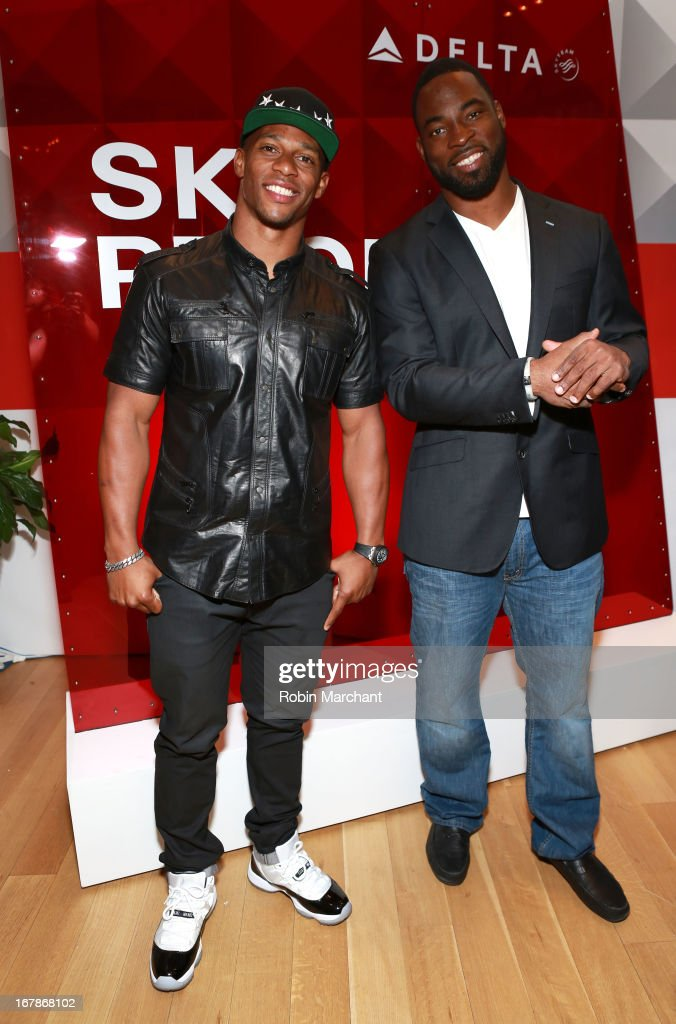 Victor Cruz and <a gi-track='captionPersonalityLinkClicked' href=/galleries/search?phrase=Justin+Tuck&family=editorial&specificpeople=748769 ng-click='$event.stopPropagation()'>Justin Tuck</a> attend as Delta Air Lines celebrate the opening night of T4X, a pop up experience showcasing distinctive features of the airline's newly transformed international hub at JFK's Terminal 4 on May 1, 2013 in New York City.