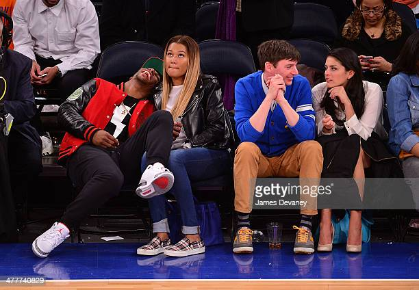 Victor Cruz Elaina Watley Mike O'Brien and Cecily Strong attend the Philadelphia 76ers vs New York Knicks game at Madison Square Garden on March 10...
