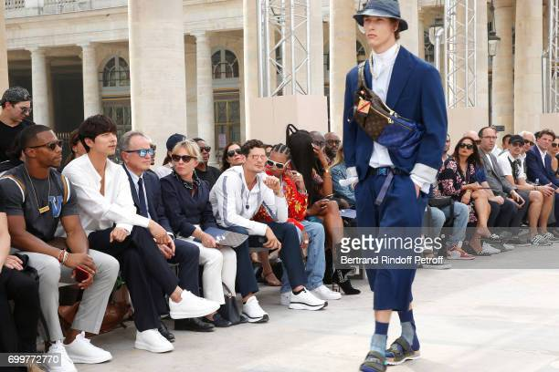 Victor Cruz Gong Yoo Chief Executive Officer of Louis Vuitton Michael Burke his wife Brigitte Burke Jeremie Laheurte Tyga and Naomi Campbell attend...
